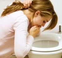 A woman who vomits at the toilet.